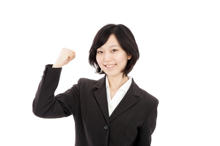 Young Japanese businesswoman hold up fists Stock Photo - 17992636