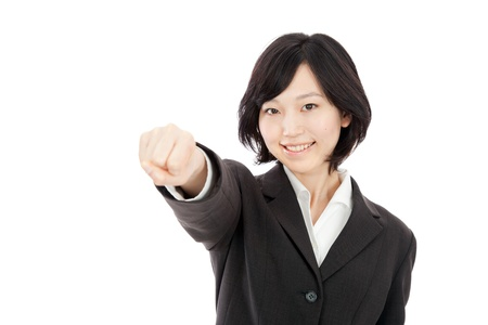 Young Japanese businessman punching in white background Stock Photo - 17992637