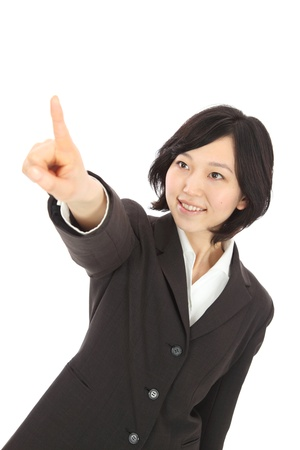 Finger pointing to the smiling young Asian women photo