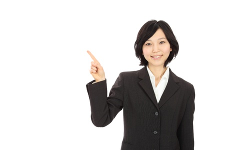 Finger pointing to the smiling young Asian women