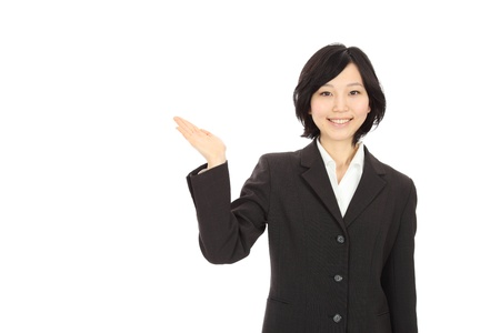 Smiling young Asian woman holding hands in white background Stock Photo
