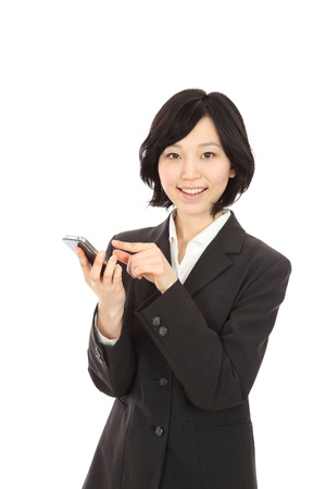 Young Asian woman smiling touch smartphone in white background photo