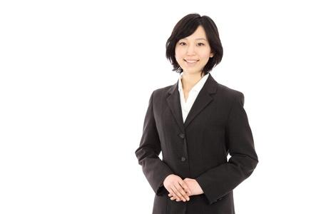 白い背景の美しい若いアジアの女性リンク手します。 写真素材