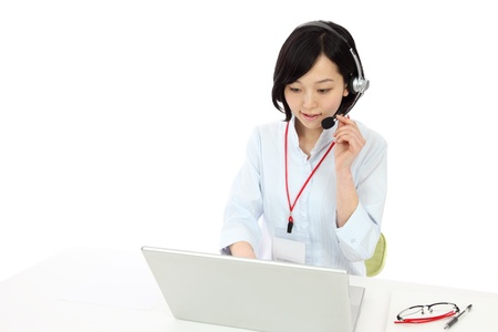 Beautiful young japanese woman operator in white background