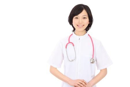 笑みを浮かべて肌触り若いアジア看護師 写真素材