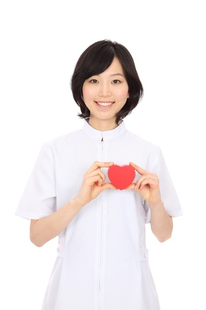 Beautiful young Asian woman's heart in white background