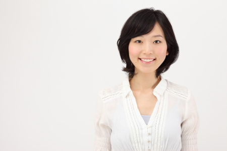 Smiling young Japanese women in white background Stock Photo