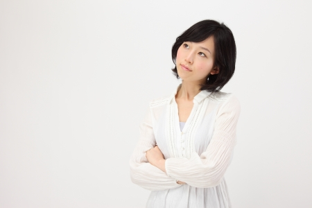 Beautiful young Japanese women think in white background Stock Photo
