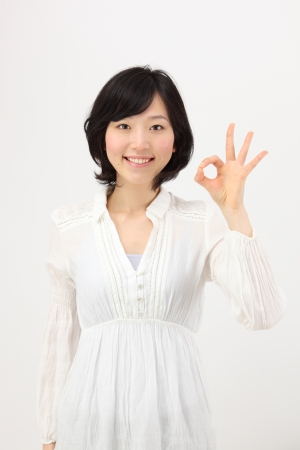 OK hands to make young japanese women in white background  Stock Photo - 18342211