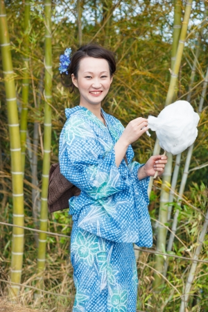 Kimono woman with cotton candy photo
