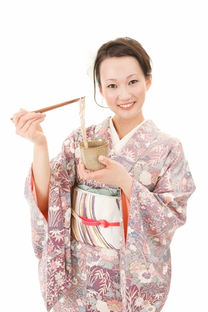 buckwheat noodle: Beautiful japanese kimono woman in white background Stock Photo