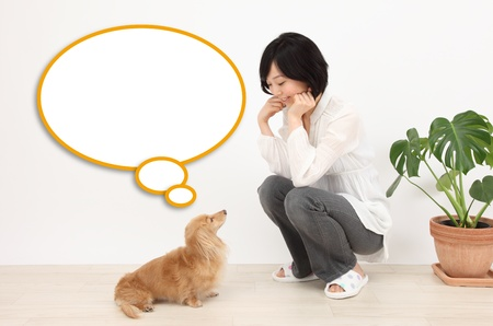 Asian women and dogs and speech balloon Stock Photo - 19406231