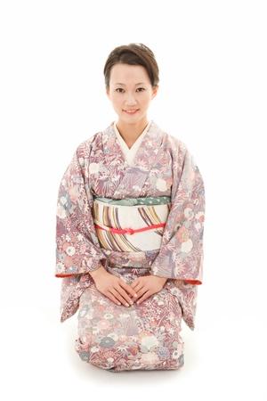 Beautiful japanese kimono woman in white background Stock Photo