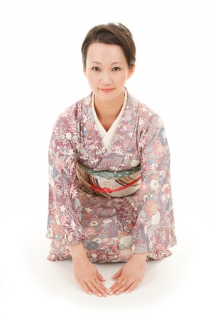 Beautiful japanese kimono woman sit in white background