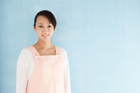 half body: Half body portrait of happy young woman blue background with copy space.