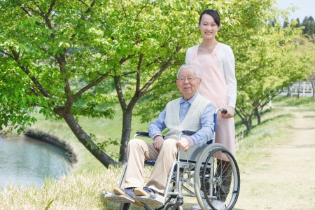 Japanese caregivers and senior smile in the field photo