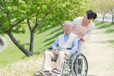 Japanese caregivers and senior smile in the field