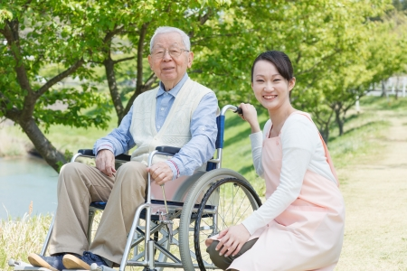 healthcare facilities: Japanese caregivers and senior smile in the field