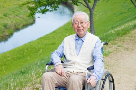 wheelchair man: Japanese senior man in the field  Stock Photo