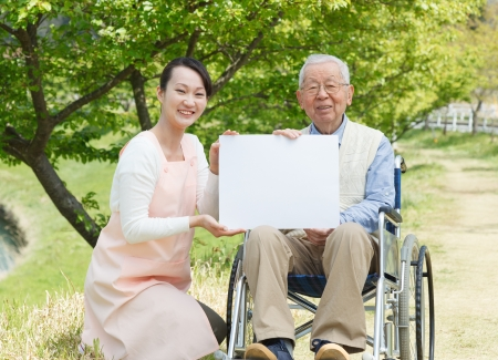 Japanese caregivers and senior in the field  photo