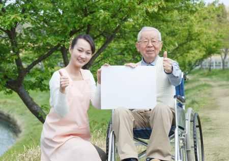 Japanese caregivers and senior with thumb up in the field  photo