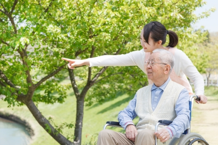 nursing young: Japanese caregivers and senior in the field Stock Photo
