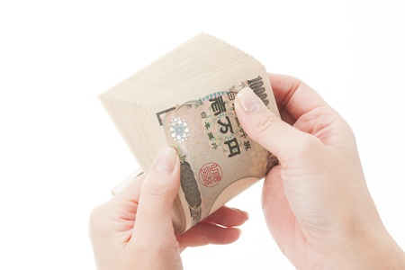 Hand to count the Japanese Yen Stock Photo