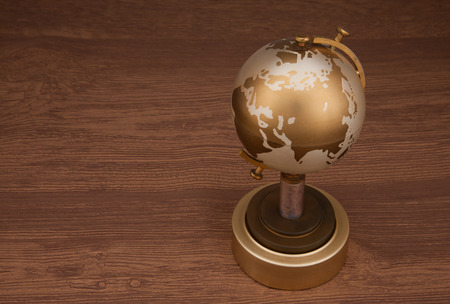 Gold globe brown background photo