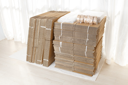 packing supplies: Cardboard a lot of stacked