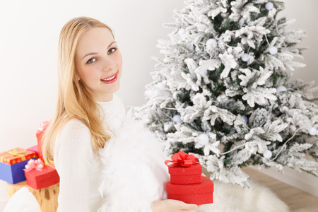Caucasian woman with a gift photo