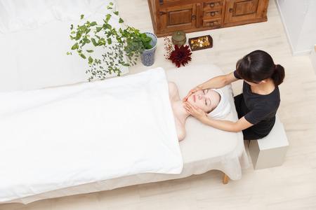bird eye view: Young woman to head massage Stock Photo