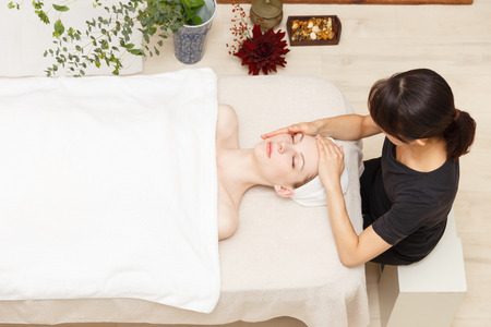 Young woman to head massage photo