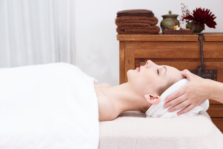 head massage: Young woman to head massage Stock Photo