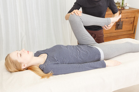 Caucasian woman undergoing a chiropractic Stock Photo