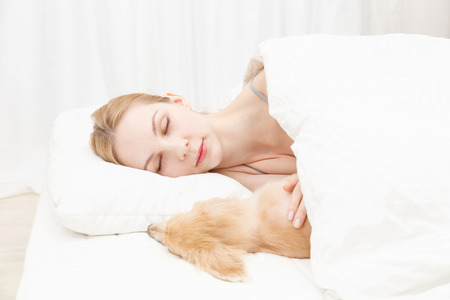 Young caucasian woman with dog photo