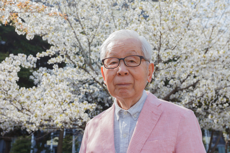 Senior citizen with cherry blossom tree
