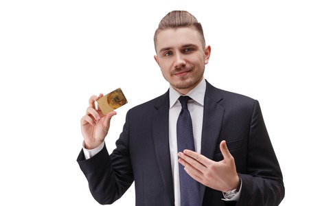 bussinessman: Portrait of young confident  bussinessman, holding gold card in his right hand.