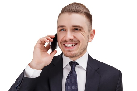Successful smiling  bussinessman talking on phone with his partner.