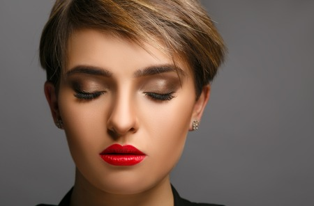 proffessional: Glamour portrait of a beautiful  lady with short hair and proffessional make up.