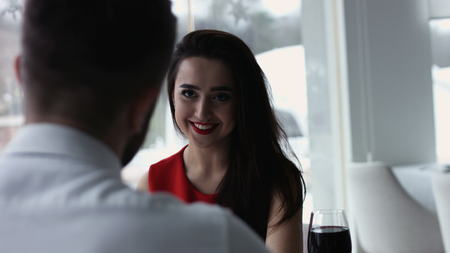 romantic evening date in restaurant happy young couple with wine glass