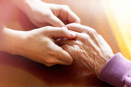 Hands of young adult and senior women. Care and elderly concept. 스톡 콘텐츠
