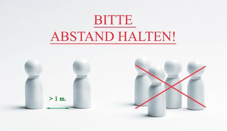 Warning sign with german writing - bitte, abstand halten, translation - please, keep your distance. Preventive measures. Social distancing.