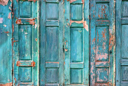 Texture of the old door. Peeling paint on wooden doors as a detailed background image