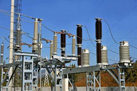 High-voltage substation with insulators, switches and disconnectors.
