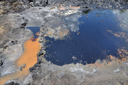Spills of crude oil on the soil surface