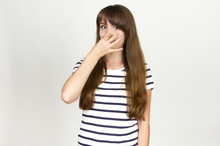 Woman holding her nose because of a bad smell Stock Photo