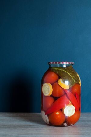 Pickled tomatoes in glass jars