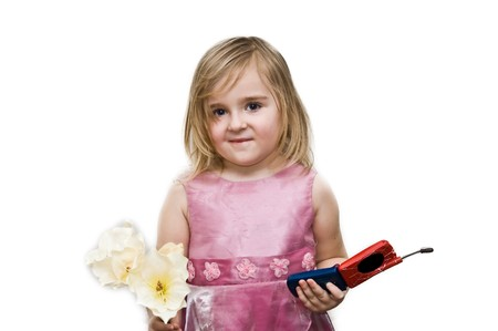4 years old girl wearing nice dress with flower in one hand and mobile in other