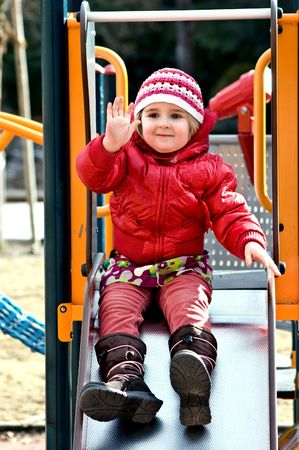 A photo of 4 years old girl on playground