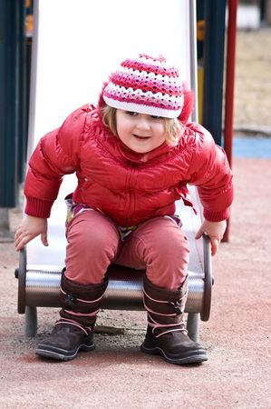 A photo of 4 years old girl on the playground